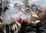 FILE - In this April 18, 2015 file photo, young partygoers listen to music and smoke marijuana during the annual 4/20 marijuana festival, in Denvers downtown Civic Center Park. Saying that weed tourists have nowhere to legally use the pot theyre buying, marijuana activists in Denver have launched a ballot initative that would ask voters whether businesses open only to people 21 and older should be permitted to allow pot use.